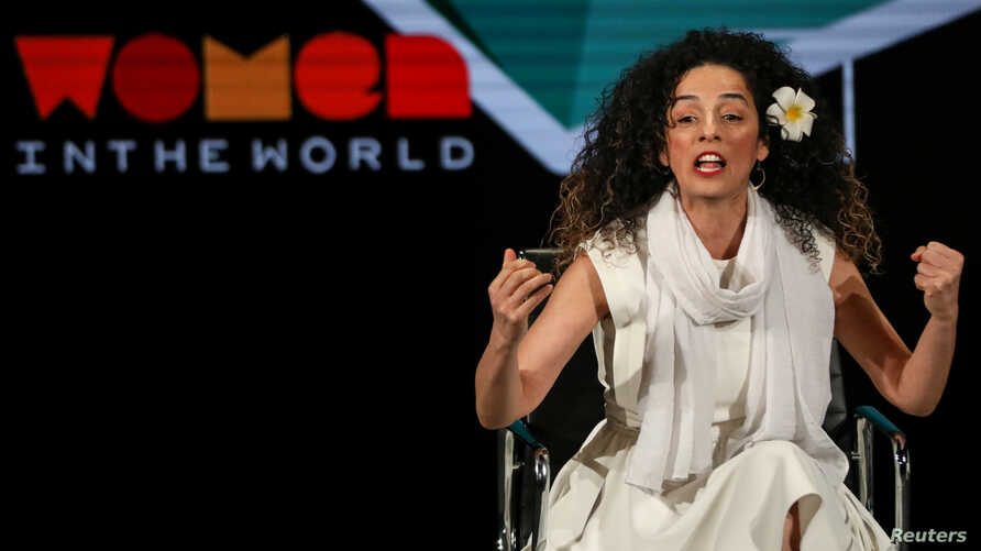 FILE - Iranian-American activist Masih Alinejad speaks at the Women in the World Summit in New York, April 12, 2019.