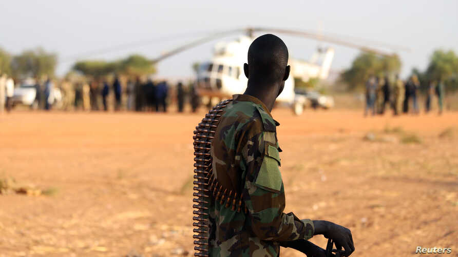 FILE - An armed member of the South Sudanese security forces is seen at the Unity oil fields in South Sudan, Jan. 21, 2019.