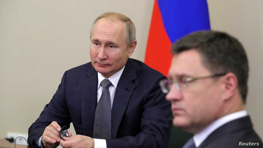 Russia's President Vladimir Putin and Energy Minister Alexander Novak take part in a ceremony launching Gazprom's Power of Siberia gas pipeline to China via a video link in Sochi, Dec. 2, 2019.