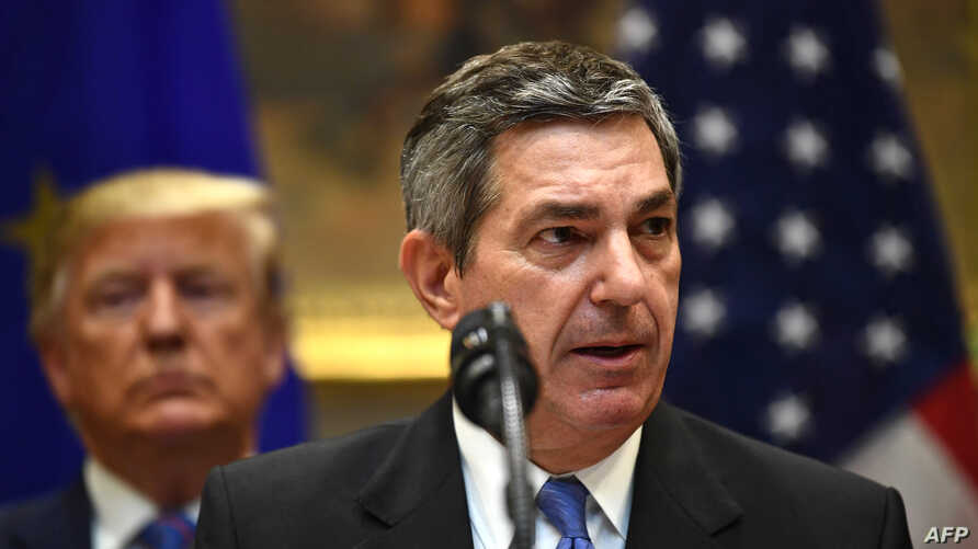 European Union Ambassador to the US Stavros Lambrinidis (C) speaks as US President Donald Trump looks on during an event on…