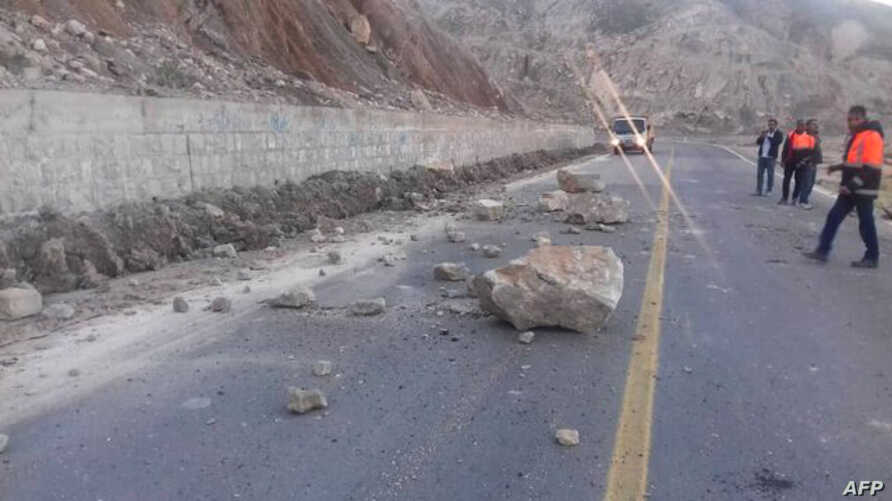 A picture taken Dec. 27, 2019, shows the Ahram-Farashband road blocked by a landslide triggered by an earthquake in Iran's southern Bushehr province.