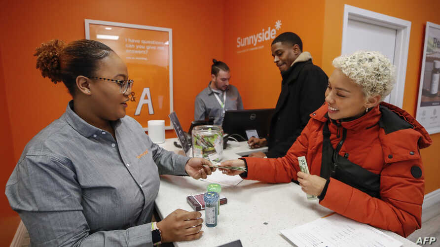 Customer Elise Swopes makes a purchase at Sunnyside Cannabis Dispensary on January 1, 2020 in Chicago, Illinois. - On the first…