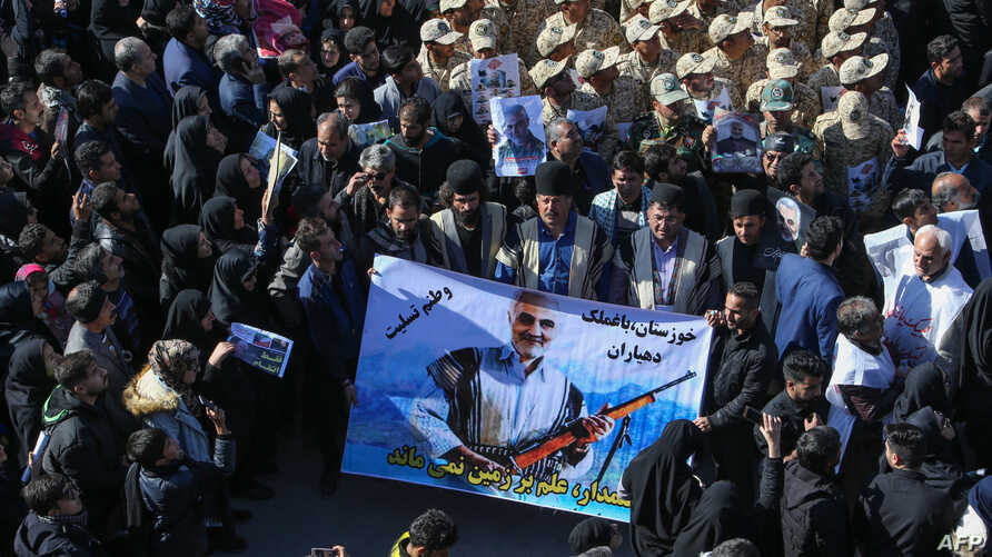 Iranian mourners gather during the final stage of funeral processions for slain top general Qasem Soleimani, in his hometown…