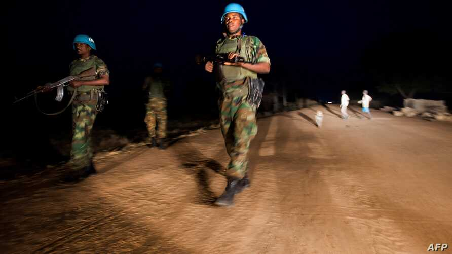 Peacekeeper troops from Ethiopia and deployed in the United Nations (UN) Interim Security Force for Abyei (UNISFA) patrol at…
