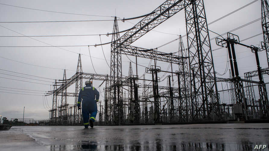 An employee of the Afam VI power plant walks past the electrical facility of the plant in Port Harcourt on September 29, 2015…