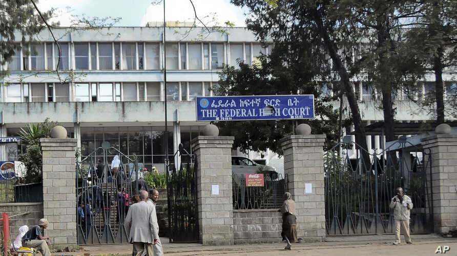 Pedestrians walk past the Federal High Court building in Addis Ababa, Ethiopia Tuesday, Nov. 1, 2011. A witness in a terror…