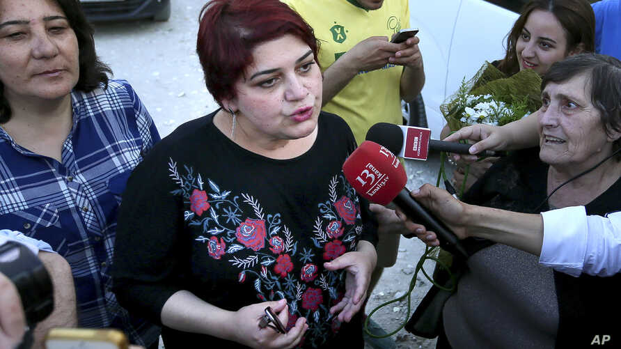 Azeri Khadija Ismayilova, center, a reporter for Radio Free Europe/Radio Liberty, who has become a symbol of defiance, praised…