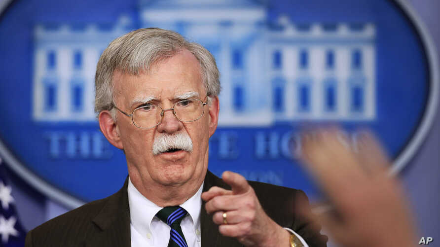 FILE - National security adviser John Bolton speaks to reporters during the daily press briefing in the Brady press briefing room.
