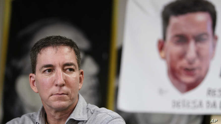 Journalist Glenn Greenwald listens to a question during a press conference before the start of a protest in his support in front of the headquarters of the Brazilian Press Association, known as ABI, in the city of Rio de Janeiro, Brazil, July 30 , 2019.
