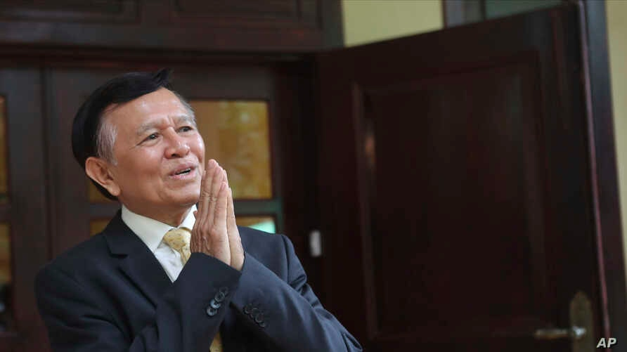 FILE - Cambodia National Rescue Party's President Kem Sokha greets to journalists in his house in Phnom Penh, Cambodia, Nov. 12, 2019.