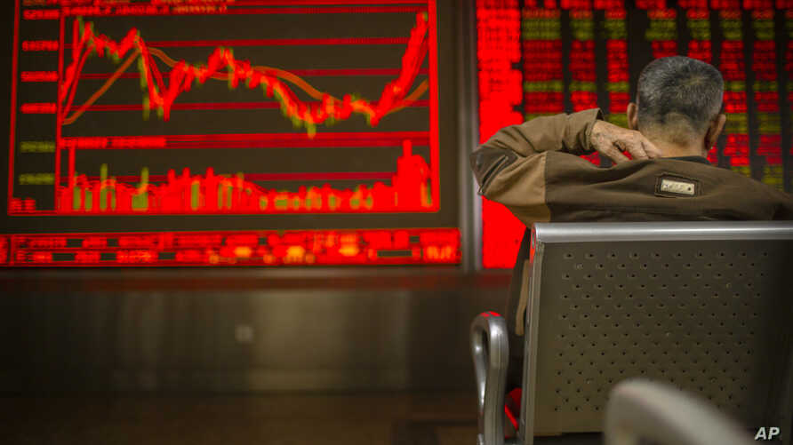A Chinese investor monitors stock prices at a brokerage house in Bejiing, Dec. 26, 2019.