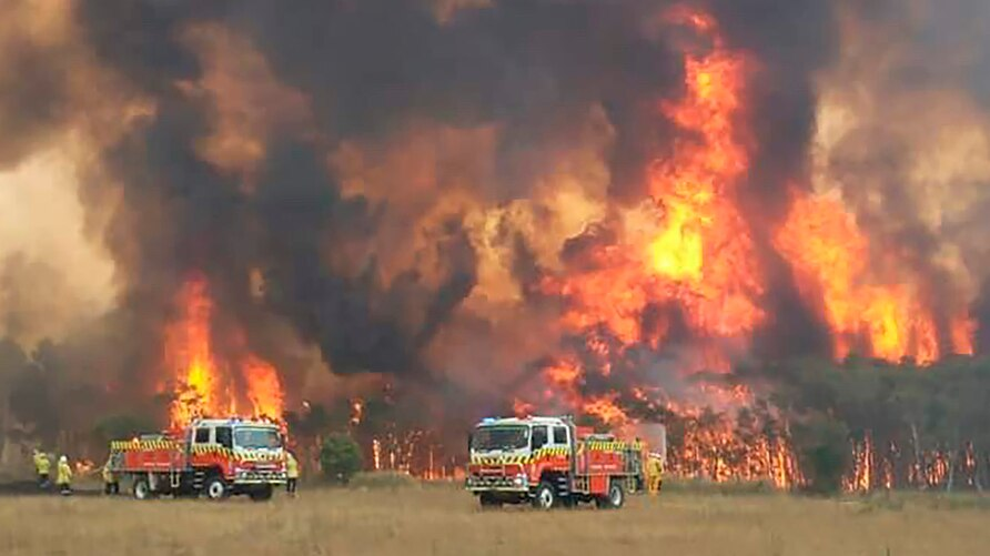 In this image dated Dec. 30, 2019, and provided by NSW Rural Fire Service via their twitter account, firefighters are seen as…