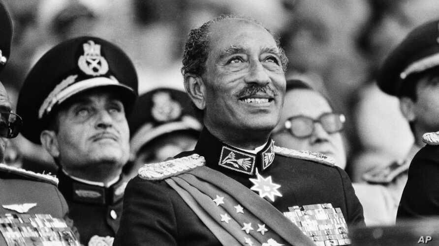FILE - Egyptian President Anwar Sadat smiles at the start of the military parade in Cairo, Oct. 6, 1981. Later, during the parade, Sadat was assassinated with eleven others when gunmen opened fire on the reviewing stand with automation weapons.