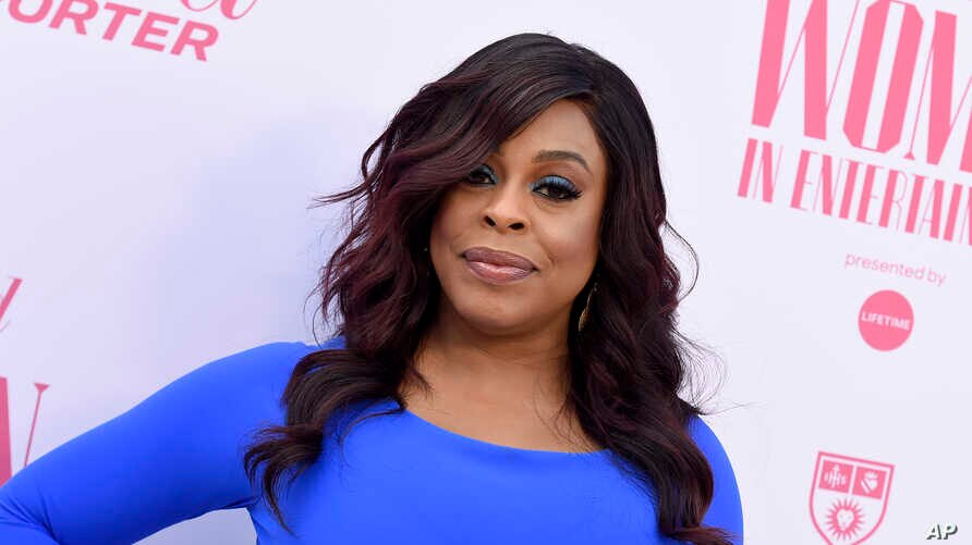 FILE - This Dec. 11, 2019 file photo shows Niecy Nash at The Hollywood Reporter's Women in Entertainment Breakfast Gala in Los…