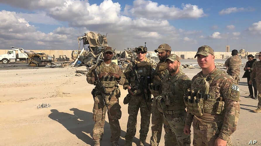 U.S. Soldiers stand at a site of Iranian bombing at Ain al-Asad air base in Anbar, Iraq, Jan. 13, 2020.