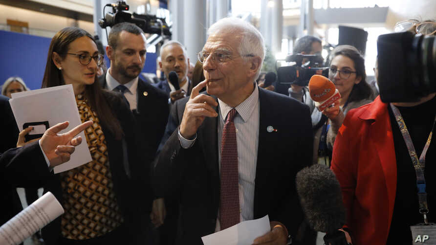 European Union foreign policy chief Josep Borrell is surrounded by reporters at the European parliament, Jan.14, 2020.