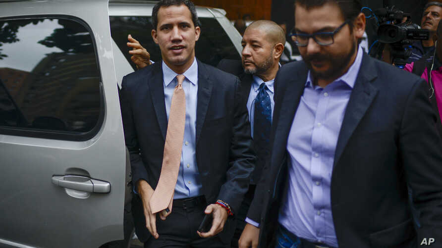 Opposition leader Juan Guaido arrives to the headquarters of the Democratic Action political party in Caracas, Venezuela, Jan. 15, 2020.
