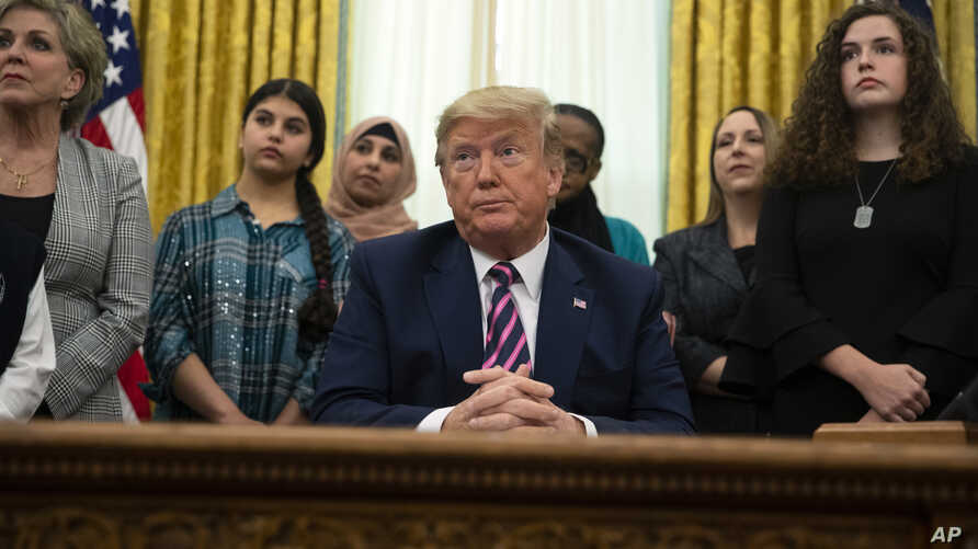 President Donald Trump listens to a question during an event on prayer in public schools, in the Oval Office of the White House…