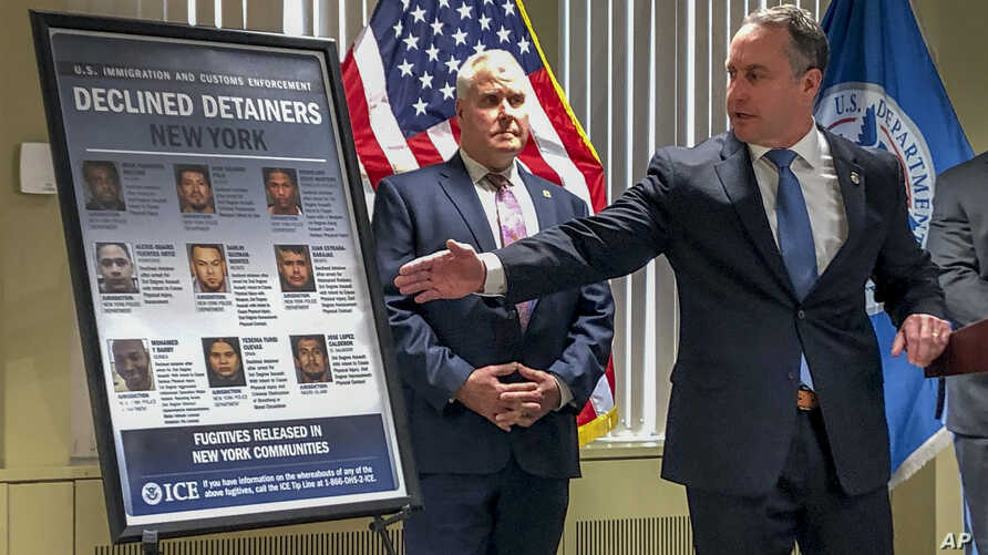 Matthew Albence, right, the acting director of U.S. Immigration and Customs Enforcement, speaks during a news conference,…