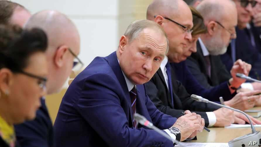 FILE - Russian President Vladimir Putin attends a meeting on drafting constitutional changes at the Novo-Ogaryovo residence outside Moscow, Russia, Jan. 16, 2020.