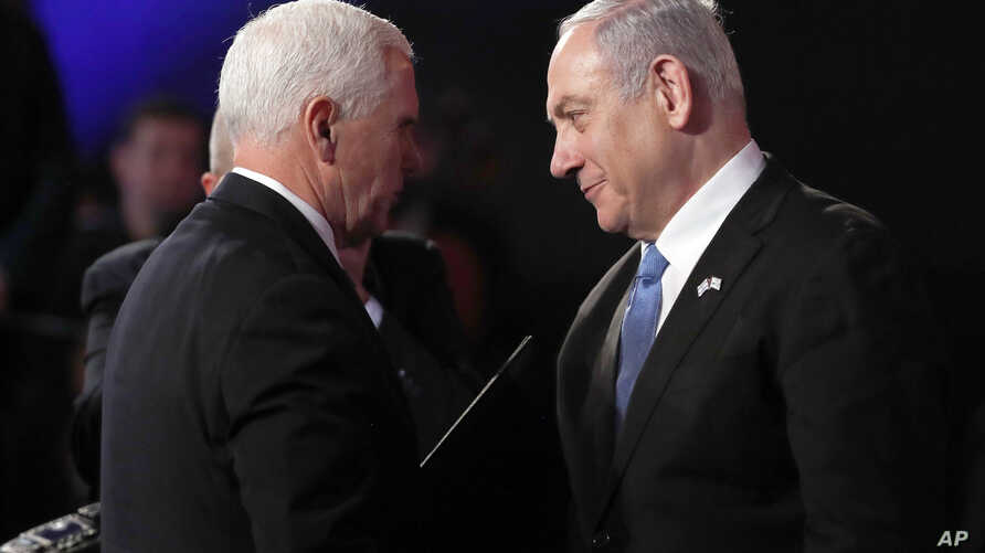 U.S. Vice President Mike Pence and Israeli Prime Minister Benjamin Netanyahu greet each other at the World Holocaust Forum in…