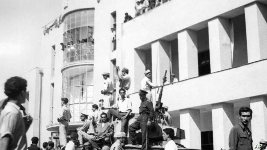 A royalist tank moves into the courtyard of Tehran radio a few minutes after pro-Shah troops occupied the place during the coup…