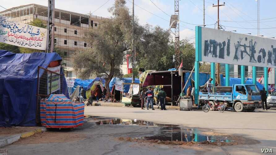 5192: Protest camps like this one in Karbala have been set up in many Iraqi cities.  Tents in Basra burned Friday night, as forc