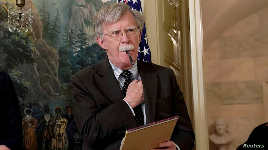 FILE PHOTO: Former National Security Adviser John Bolton listens to U.S. President Donald Trump's statement on Syria at the…