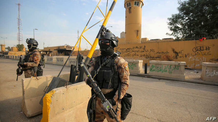 Iraqi counter-terrorism forces stand guard in front of the U.S. embassy in the capital Baghdad, Jan. 2, 2020.