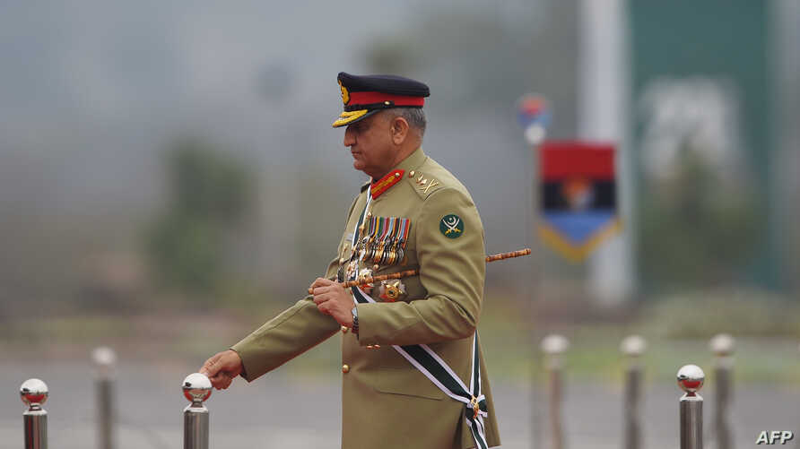 FILE - Pakistan Army Chief General Qamar Javed Bajwa arrives to attend the Pakistan Day parade, in Islamabad, March 23, 2019.
