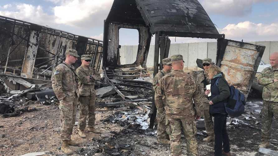 U.S. soldiers stand amid damage at a site of Iranian bombing at Ain al-Asad air base, in Anbar, Iraq, Jan. 13, 2020.