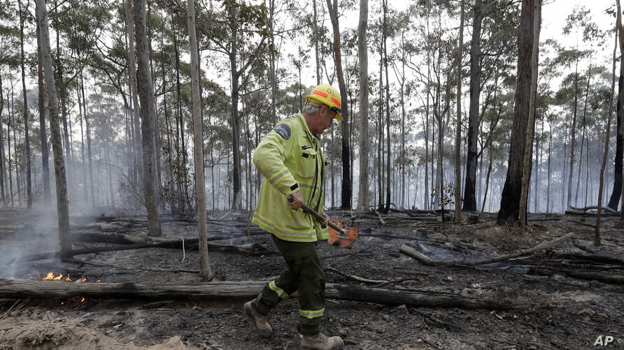 Forestry Corportaion worker Dale McLean patrols a controlled fire at a wildfire near Bodalla, Australia, Jan. 12, 2020.