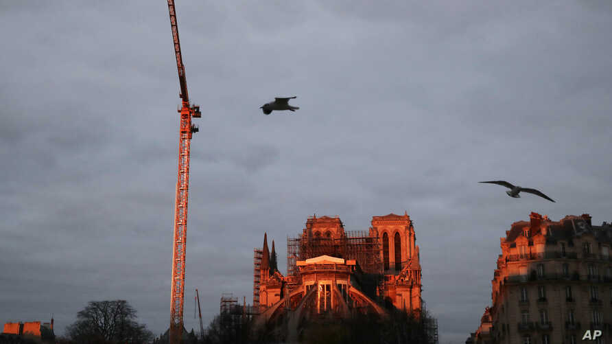 Notre Dame cathedral is pictured when the sun rises, in Paris, France, Jan. 4, 2020.
