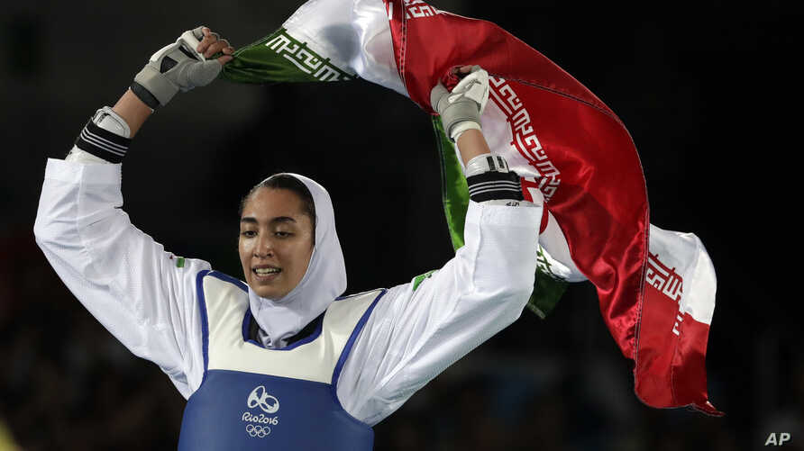 FILE - Kimia Alizadeh Zenoorin of Iran celebrates after winning the bronze medal in a women's Taekwondo 57-kgcompetition at the 2016 Summer Olympics in Rio de Janeiro, Brazil, Aug. 18, 2016.