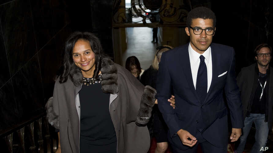 FILE - Daughter of former Angolan President Jose Eduardo dos Santos, Isabel dos Santos, and her husband Sindika Dokolo arrive for an event at the City Hall in Porto, Portugal, March 5, 2015.