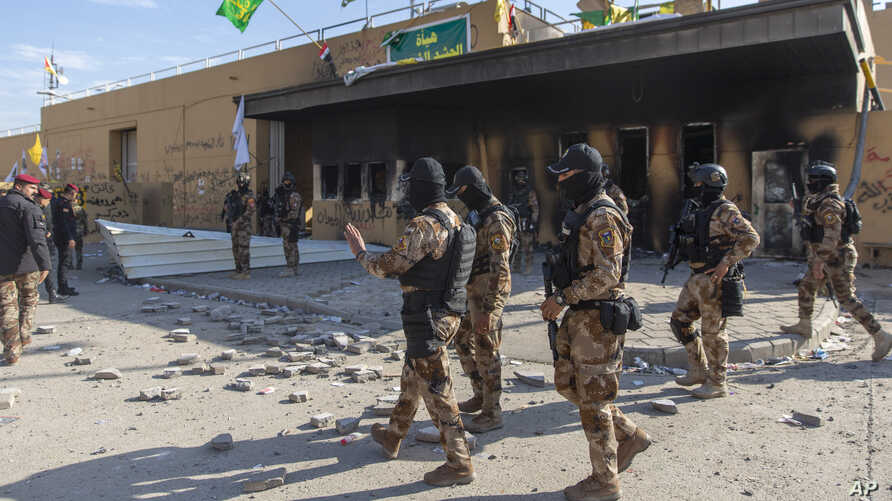 Iraqi army soldiers are deployed in front of the U.S. embassy in Baghdad, Iraq, Jan. 1, 2020, after Iran-backed protesters withdrew from the compound.