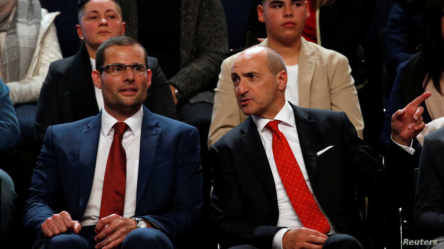 Leadership contenders Robert Abela, left, and Chris Fearne, right, attend outgoing Prime Minister Joseph Muscat's final speech at the party's Congress at the Corradino Sports Pavilion in Paola, Malta, Jan. 10, 2020.