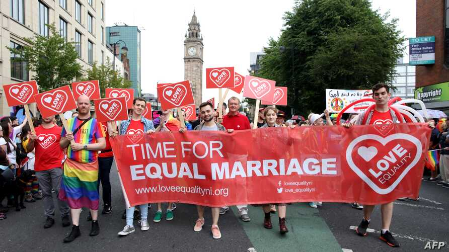 Members of the Lesbian, Gay, Bisexual and Transgender (LGBT) community and supporters take part in the Belfast Pride Parade…