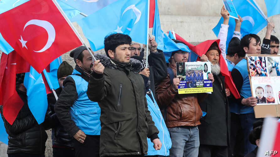 Uighurs living in Turkey stage a demonstration to commemorate the anniversary of the deadly ethnic unrests of 1997 in Gulja,…