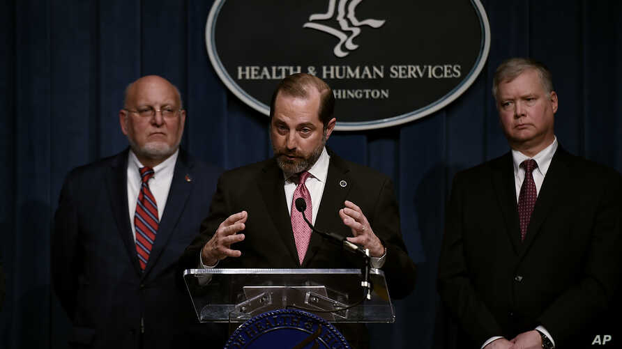 Human Services Secretary Alex Azar speaks as Centers for Disease Control and Prevention (CDC) director, Robert R. Redfield (L)…