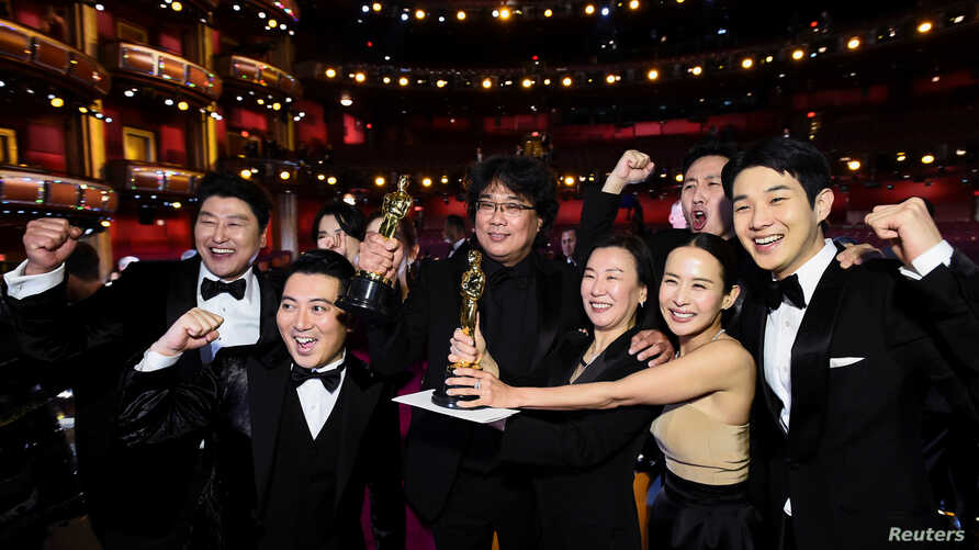 "Bong Joon Ho and the cast of ""Parasite"" pose at the 92nd Academy Awards in Hollywood, Los Angeles, California."