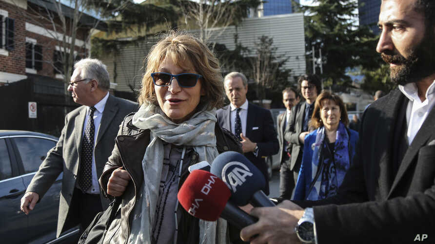 United Nations Special Rapporteur Agnes Callamard, surrounded by members of the media walks around the Saudi Consulate,…