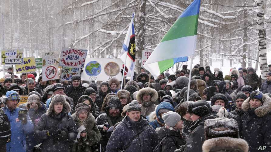 n this photo taken Feb. 3, 2019, protesters rally against plans by authorities to accept trash from Moscow, in Arkhangelsk, Russia. Protesters have rallied in more than a dozen Russian cities and towns against waste management.