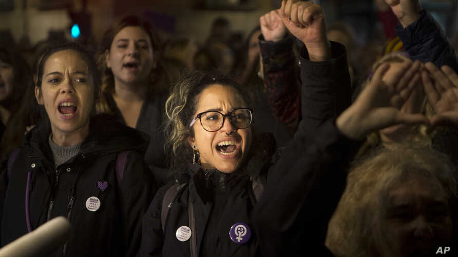 Women shout outside the Justice Ministry in Madrid, Nov. 4, 2019. People are demonstrating to demand changes in criminal laws and the country's judiciary after a new ruling on a sex assault case revived the debate over the fair treatment of victims.