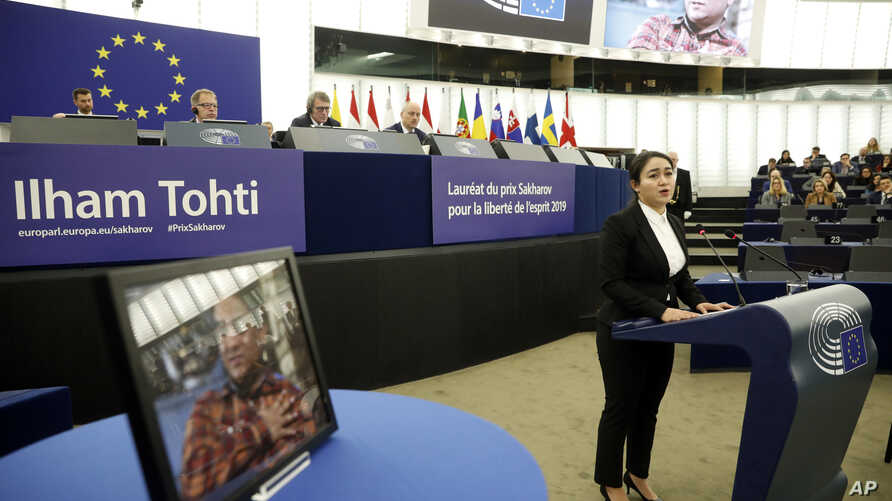 Jewher Ilham, daughter of imprisoned Uighur scholar Ilham Tohti speaks during the Sakharov Prize ceremony at the European Parliament, in Strasbourg, eastern France, Dec. 18, 2019.