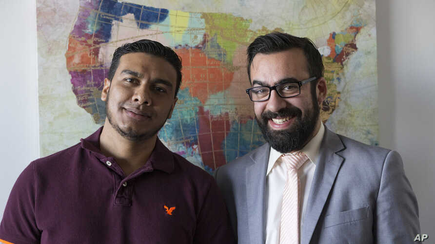 In this Jan. 6, 2020, photo, Michael Navas Gomez, left, poses for a photo with his attorney, Joshua Greer at his office in Los…