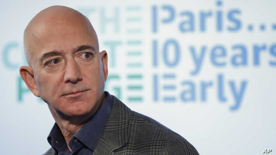 FILE - In this Sept. 19, 2019, file photo, Amazon CEO Jeff Bezos speaks during his news conference at the National Press Club…