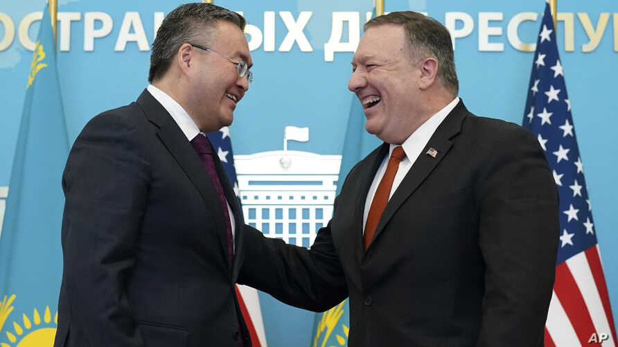U.S. Secretary of State Mike Pompeo, right, reacts after holding a joint news conference with Kazakh Foreign Minister Mukhtar…