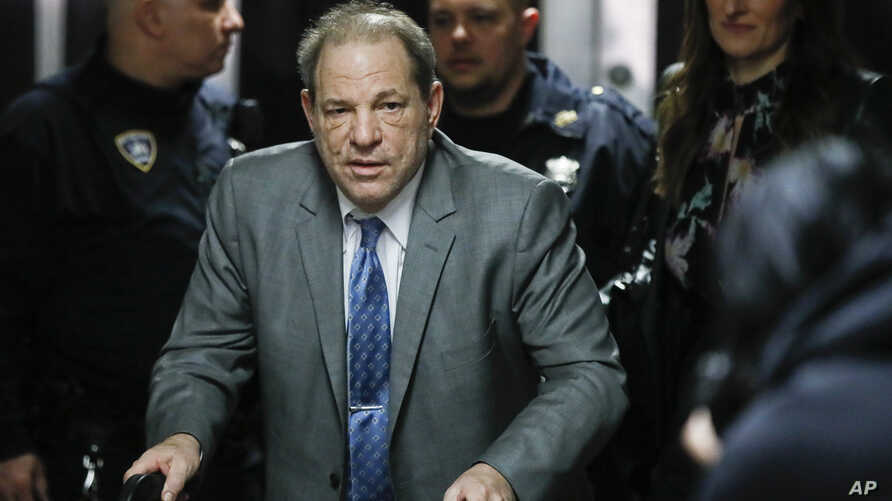 Harvey Weinstein leaves a Manhattan courthouse during his rape trial, Tuesday, Feb. 18, 2020, in New York. (AP Photo/John…
