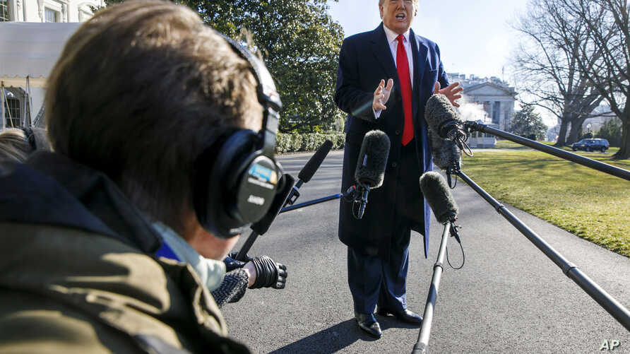 President Donald Trump speaks to the media as he leaves the White House,Feb. 23, 2020, in Washington, en route to India.